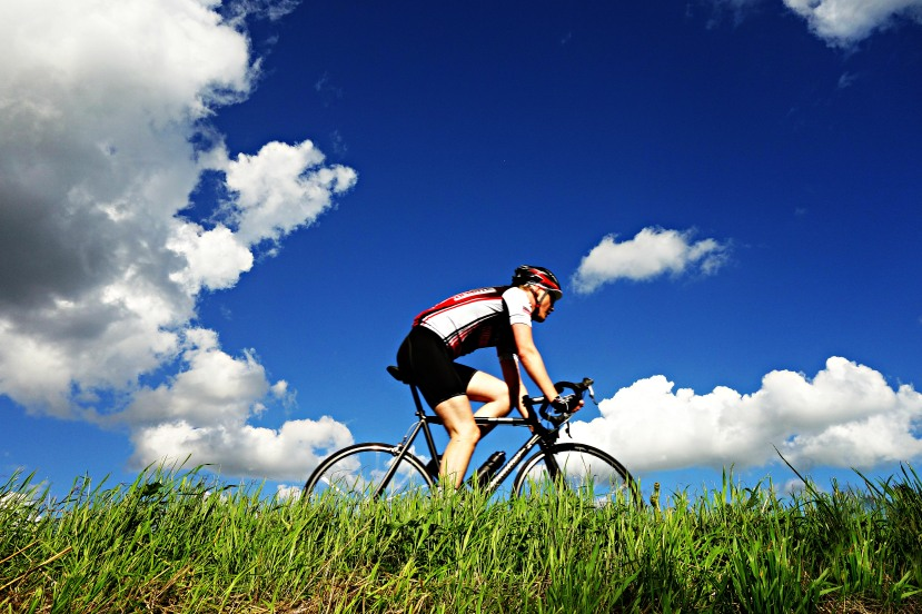 cyclist-riding-under-blue-skies.jpg